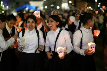 Nuns participate in a procession to commemorate the 38th anniversary of the murder of late Archbishop of San Salvador Oscar Arnulfo Romero in San Salvador