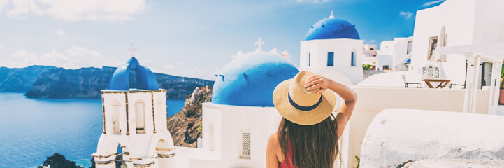 Wall Mural - Summer travel tourist visiting Oia, Santorini, Europe vacation destination. Luxury holiday woman walking in city. Banner panorama.