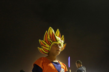 A boy, dressed as the character Goku, is pictured as he meets with other fans to watch the episode 130 of the Dragon Ball Z anime at the Plaza de la Mexicanidad square in Ciudad Juarez