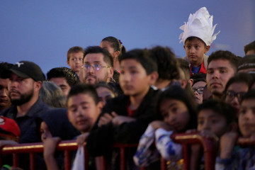 A boy looks on as he meets with other fans to watch the episode 130 of the Dragon Ball Z anime at the Plaza de la Mexicanidad square in Ciudad Juarez