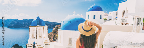 Wall mural Summer travel tourist visiting Oia, Santorini, Europe vacation destination. Luxury holiday woman walking in city. Banner panorama.