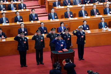 Members of the Central Military Commission take an oath to the Constitution at the sixth plenary session of the NPC at the Great Hall of the People in Beijing