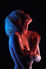Naked Blonde Girl in Colorful bright lights
