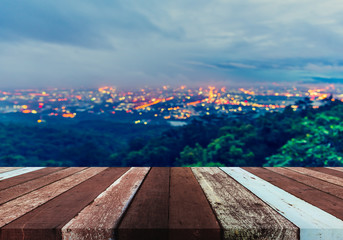 wood table and blurred city bokeh.