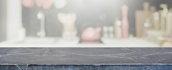 Empty Black stone table top and blurred kitchen interior banner background - can used for display or montage your products.