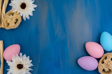 Beautiful Easter composition: colorful dyed eggs on a dark blue background