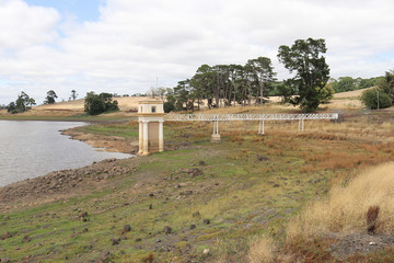 Intake tower and service bridge at Malmsbury Reservoir in Australia