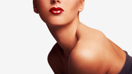 Side section lips portrait of a beautiful young classic beauty woman with shoulder, isolated against a white background, indoors.