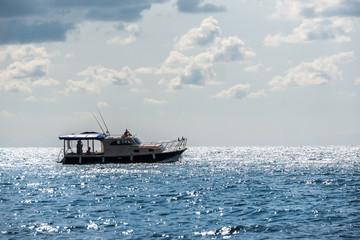 sport fishing boat in the sea. beautiful cloudy sky