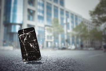 Obraz Handy fällt auf Straße - fototapety do salonu
