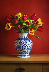 Still life with colorful tulips in the chinese vase