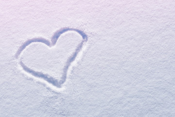 Drawn heart shape on snow with copy space (toned)