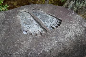 Buddha's foot print on stone. 仏足石