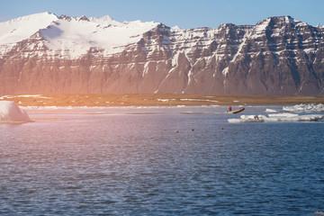 Volcano rock mountain over blue lake, Iceland winter season natural landscape background