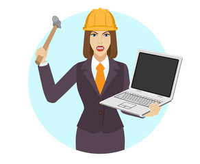 Businesswoman in construction helmet trying to break a laptop notebook with a hammer
