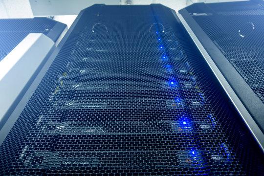 Server room in data center full of telecommunication equipment. internet. big data storage. futuristic techno design on background of fantastic supercomputer data center. multiple exposure.
