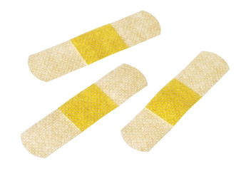 Medical adhesive plasters on white background