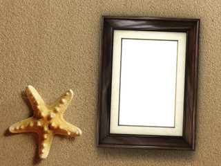 Pictue frame on shells and sand background. Copy space.