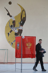 A voter visits a polling station during the presidential election in a settlement in Stavropol Region