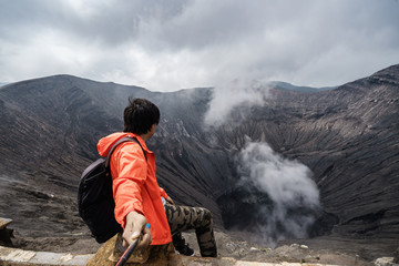 Traveler at crater volcano at Bromo (Gunung Bromo) an active volcano in the Bromo Tengger Semeru National Park, East Java, Indonesia