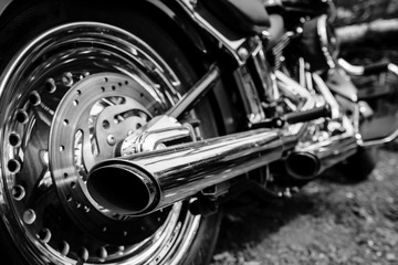 Rear view of motorcycle exhaust chrome pipes
