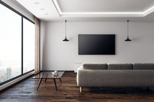 Contemporary living room with empty TV front