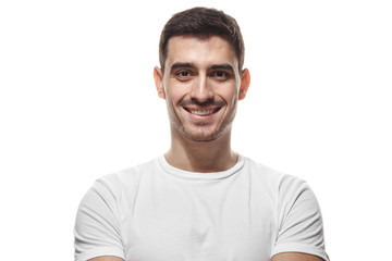 Close up portrait of smiling handsome man in white t-shirt looking at camera, isolated