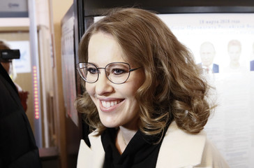 Presidential candidate Sobchak visits a polling station during the presidential election in Moscow