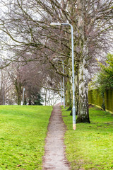Town park pedestrian footpath with lamp stands in Daventry town centre