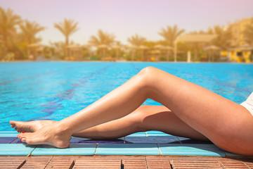 Beautiful woman legs at swimming pool in Egypt