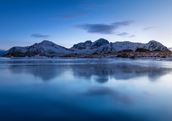 Mountain ridge and reflection in the lake. Natural landscape in the Norway