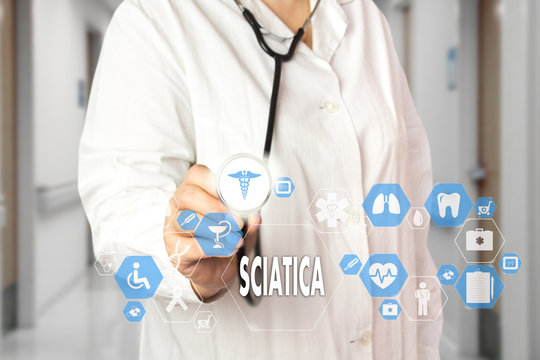 Medical Doctor  and words SCIATICA  in Medical network connection on the virtual screen on hospital background.