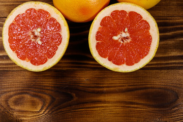 Ripe fresh grapefruits on wooden table