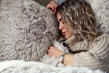 beautiful woman is sleeping and dreaming on soft bed.