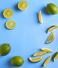 Fresh limes on light blue background