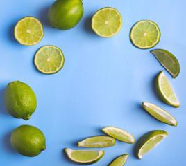 Fresh limes on light blue background
