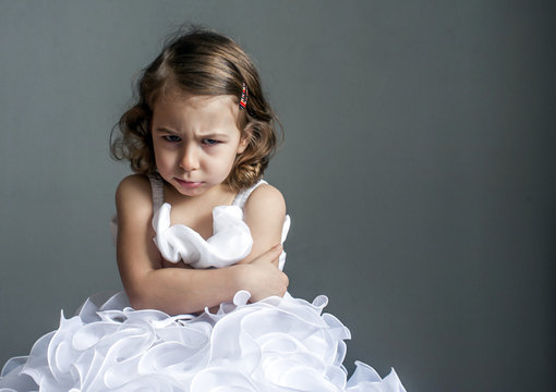 little princess in a bad mood. Children's emotions: resentment, anger