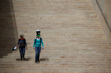 People walk down the steps at the entrance to Valletta to take part in the St Patrick's Weekend Parade in Valletta