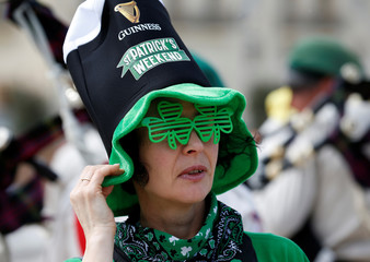 A participant attends the St Patrick's Weekend Parade in Valletta