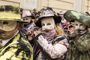 Steinenberg, Basel, Switzerland - February 19th, 2018. Close-up of carnival participants playing piccolo flute during the parade