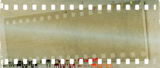 Grunge double film strip frame in sepia tones.