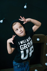 Little dancer. Fashionable little boy. Hip-Hop style. Young rapper. Funny child in cap.