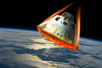 Reentry of space capsule into Earth's Atmosphere. - Elements of this image courtesy of NASA.