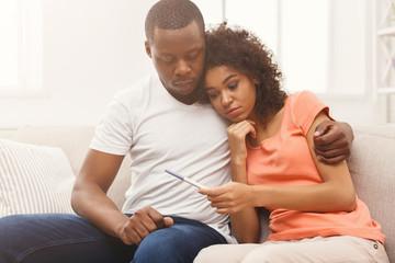 Sad black couple after pregnancy test result