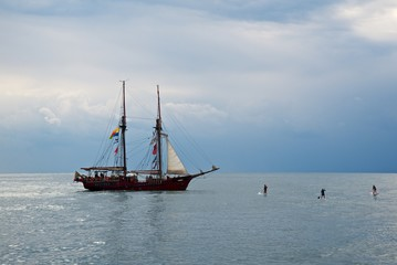 Tall ship race in the Black sea. Large white sails on masts. Beauty seascape.