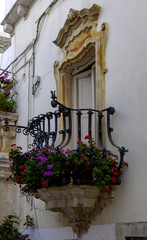 Beautiful baroque balcony in the historic center of Locorotondo, Puglia - ITALY
