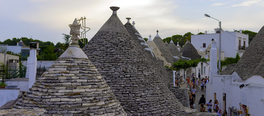 street view of alberobello, famouse trulli town in italy