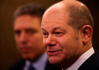 Germany's Finance Minister Olaf Scholz attends a news conference next to Argentina's Treasury Minister Nicolas Dujovne during the 2018 G20 Conference in Buenos Aires