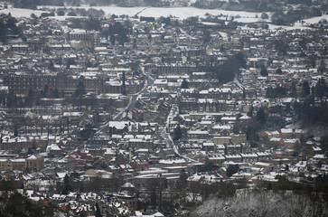 Snow covers the buildings below the Heights of Abraham country park, in Matlock Bath