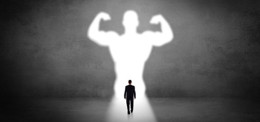 Businessman standing in front of a strong hero vision Wall mural